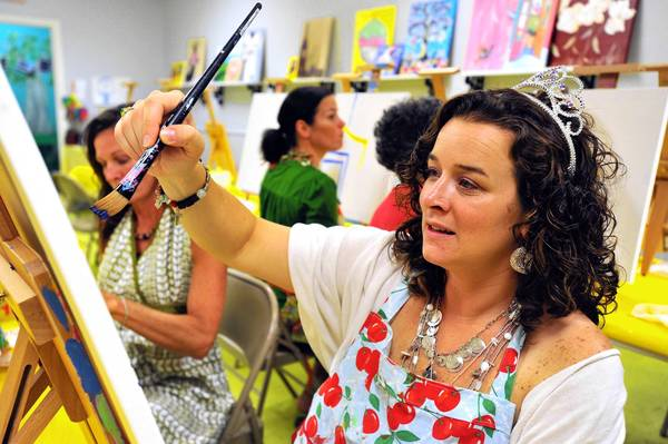Birthday girl Erin Joyce of Allentown paints a French cafe scene during a party with friends at Roey's Paintbox Parties, 453 Main St., in Bethlehem.
