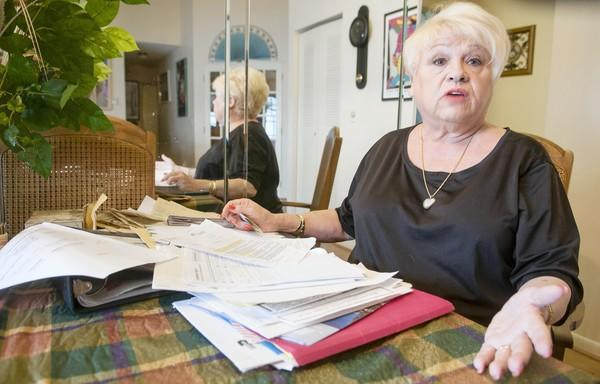 Diana Latzko, a Citizens policyholder in Davie, gathered an arsenal of documents and permits before a Citizens' inspector showed up at her home to verify hurricane-resistant upgrades.
