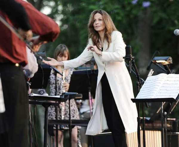 Rachael Worby, artistic director of Muse/ique, conducted the orchestra in its first concert of the season held in the olive grove at the Caltech campus.
