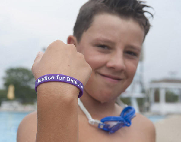 "Will Gibson, 12, of Danville, shows off his ""Justice for Danielle"" band."