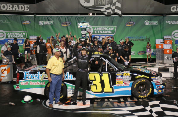 James Buescher, driver of the #31 Fresh from Florida Gulf Seafood Chevrolet, holds the trophy after winning the NASCAR Camping World Series American Ethanol 225 at Chicagoland Speedway.