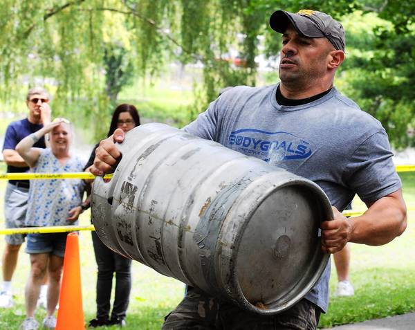 Chris Perticari of Port Murray, Warren County, New Jersey carries a filled keg on Saturday at Cedar Beach in Allentown.