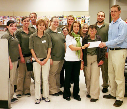 The Shopko Foundation¿s community charitable grant program recently presented the Boys and Girls Club of Aberdeen Area with a check. The grant program recognizes nonprofits for their efforts and commitment to their community. The funds will be used to further enhance the club's outcome-based programming offered to its members. Front row, from left: Britney Matthews, Holly Barkley, Tomomi Frohling, Angela Eckart, Rocky Deilke, manager of Aberdeen's Shopko, Linda Knoll and Bryan Kriech, resource development director for the club. Back row, from left: Mike Fiedler, Kelli Hart, Cheryl Zacher, Tami Lawson, Kayla Knettel and Eric Aadland.