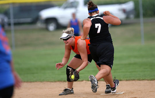 Erin Huddlson, left, of Vision Care of Sioux Falls catches the ball at second base as Dee Siehndel, right, of Chaser¿s of Sioux Falls tries to beat out the throw on Saturday at the South Dakota 12-inch slow pitch softball state women¿s softball tournaments at the North Complex. The tournament continues today at the North Complex.