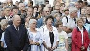 OSLO (Reuters) - Norwegians by the thousands gathered on Sunday at somber memorials to the 77 people killed a year ago by far-right gunman Anders Behring Breivik to show his bloody rampage had done nothing to change their dedication to an open society.