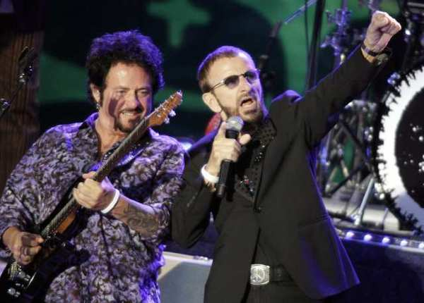 Ringo Starr, right, is joined by Toto guitarist Steve Lukather on Saturday at the Greek Theatre in Los Angeles.