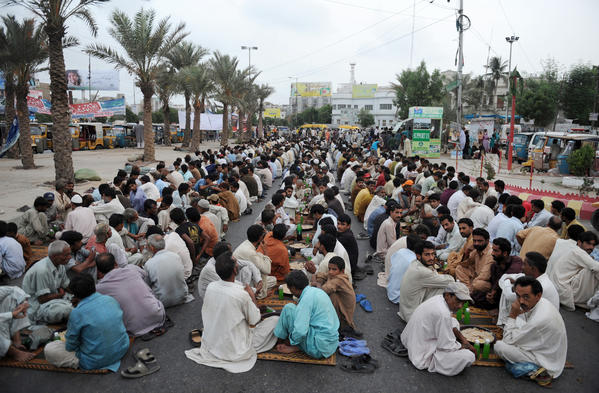 Pakistani Muslims break their fast in Karachi on Sunday during the Muslim fasting month of Ramadan. Muslims fasting in the month of Ramadan must abstain from food, drink and sex from dawn until sunset, when they break the fast with the meal known as Iftar.