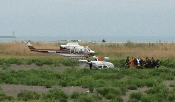 Emergency crews at the scene of a plane crash at 9500 south along Lake Michigan. Chicago Fire Department photo.