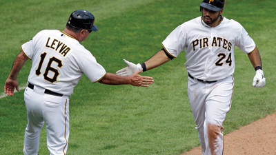 Pittsburgh Pirates' Pedro Alvarez (24) rounds third to greetings from coach Nick Leyva (16) after hitting a two-run home run in the seventh inning against the Miami Marlins on Sunday.