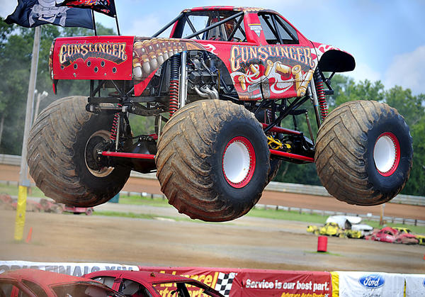 Monster truck Gunslinger clears several cars Sunday during The Advance Auto Parts Monster Jam at the Hagerstown Speedway.