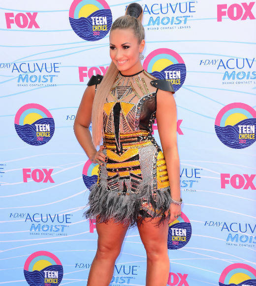 2012 Teen Choice Awards best and worst moments: TCA co-host Demi Lovato showed up with about four extra feet of hair sprouting from the top of her head and wearing a dress that wouldve maybe been more at home in a production of The Lion King. Girl -- sometimes more is just more.   -- Liz Kelly Nelson, Zap2it