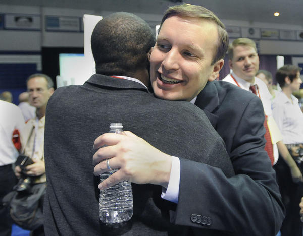 Rep. Chris Murphy, facing, embraces New Britain delegate Arthur Perry at the Connecticut Democrats 2012 State Convention at Central Connecticut State University's Kaiser Hall Saturday. Murphy was nominated as a candidate for U.S. Senate.