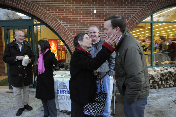 "Candee Brohinsky, of Simsbury, reaches to embrace Congressman Chris Murphy during his ""Congress on Your Corner"" event at Fitzgerald's Foods in Simsbury Thursday night. Second from left is Simsbury First Selectman Mary Glassman. At center is Deputy First Selectman John Hampton."