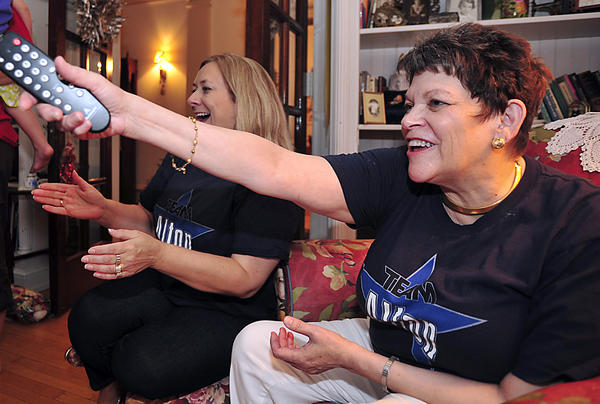 "Jan Warner, right, of Hagerstown and her friend, Teresa Moreland, of Falling Waters, W.Va., react while watching Jan's son, Justin Warner, on the finale episode of ""The Next Food Network Star,"" where Justin is a finalist."