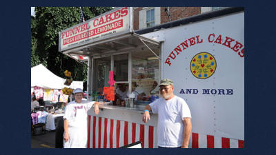 Durina and Richard Grine in front of their funnel cake stand at Somerfest Sunday afternoon. After 13 years as a vendor, they are looking to finally retire.