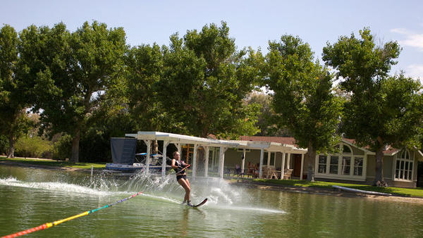 Tracy Justo prepares to take a sharp turn while water-skiing in Imperial Lakes Sunday. Union Pacific withdrew its application to build an industrial uploading facility across from this community in western Imperial County on July 16.