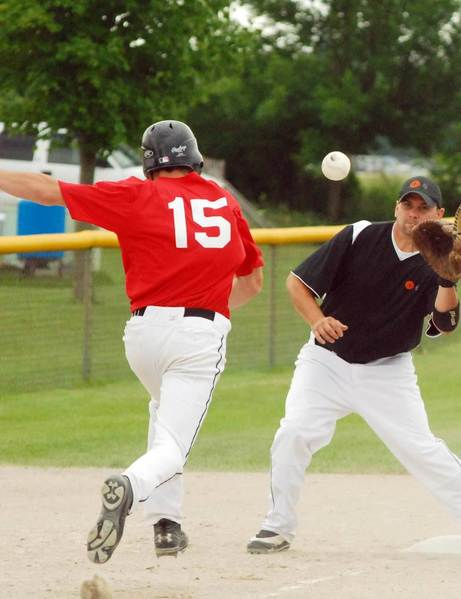 Denzil Wilson (right) of EJ waits for the ball as Blake Landosky of Big Apple Bagels of Midland scampers back to third base during a game in the Class C Men's Fast Pitch State Finals Tournament in Charlevoix on Saturday.