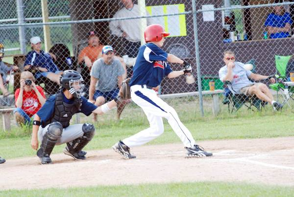 Derick Willis (right) of the Boyne City Little League Junior Division (ages 13-14) tournament team connects for a base hit against Sault Ste. Marie during a Sectional Tournament game Saturday at Pioneer Park in Pellston. Boyne won the best-of-three tournament to gain a berth in the state finals.