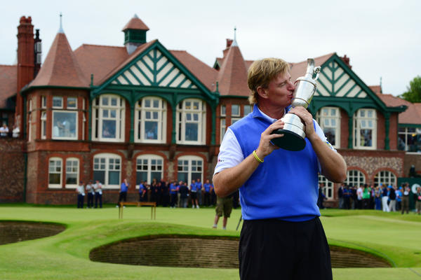 Ernie Els celebrates with the championship trophy after the final round of the 2012 British Open Championship at Royal Lytham & St. Annes Golf Club.