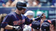 KANSAS CITY, Mo. — Ryan Doumit put his name in the Twins' record book Sunday, accomplishing something no Minnesota player had done in 20 years.