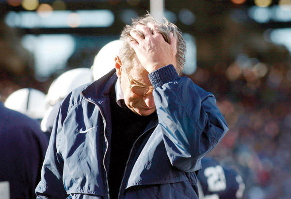 Penn State coach Joe Paterno pauses on the sidelines during the fourth quarter of his team's 14-7 loss to Northwestern in State College, Pa. in this file photo from 2004. The NCAA has slammed Penn State with an unprecedented series of penalties, including a $60 million fine and the loss of a Paterno's victories from 1998-2011, in the wake of the Jerry Sandusky child sex abuse scandal.