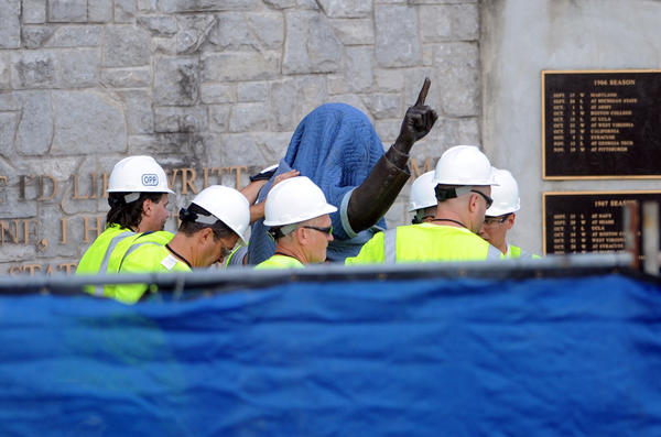 Penn State Office of Physical plant workers cover the Joe Paterno statue near Beaver Stadium on Penn State's campus in State College, Pennsylvania, on Sunday, July 22, 2012.