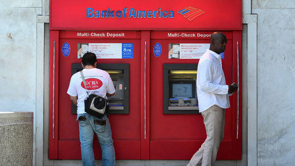 Bank customers use a Bank of America automated teller machine in Hollywood.