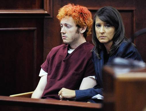 James Holmes, left, with his public defender Tamara Brady, makes his first court appearance at the Arapahoe County Courthouse in Centennial, Colo.