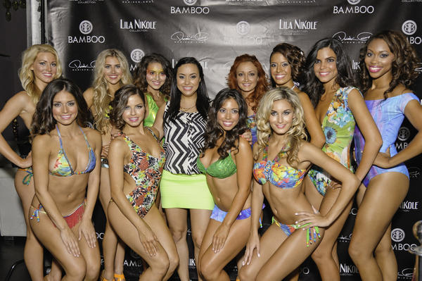 The Swimwear designer poses for a photo with the Miami Dolphin Cheerleaders.
