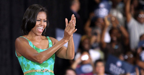 First lady Michelle Obama responds to cheering supporters at the University of Central Florida in Orlando.