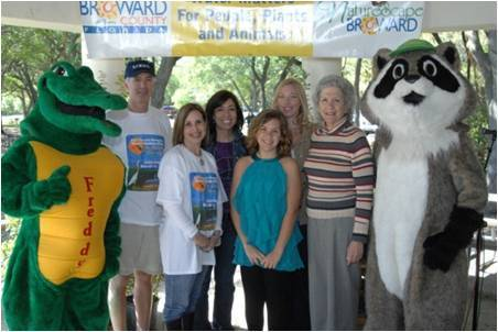 SFWMD mascot Freddy the Alligator, SFWMD Governing Board Member Glenn Waldman, School Board Member Patricia Good, New River Middle School (NRMS) Principal Priscilla Ribiero, Middle School Literary Contest winner Abby Hodder (student, NRMS), Katherine O¿Fallon (teacher, NRMS), Broward County Mayor Sue Gunzburger, and National Wildlife Federation mascot Ranger Rick at during Water Matters Day 2011.