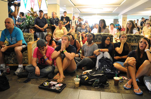 People at the HUB building at Penn State University react to hearing NCAA sanctions against the university including a fine as well as ban from bowl games and striking wins from the team's records due to the response of the university to the handling of the Jerry Sandusky child molestation charges.