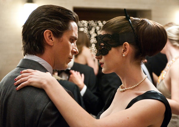 "Christian Bale and Anne Hathaway star in ""The Dark Knight Rises"""