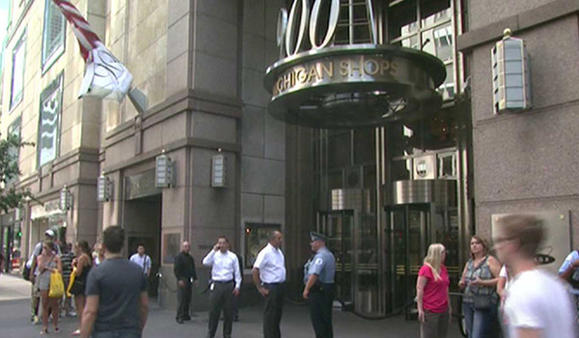 Access to the 900 N. Michigan Avenue building was blocked as rescuers tried to save a man threatening to jump. WGN-TV