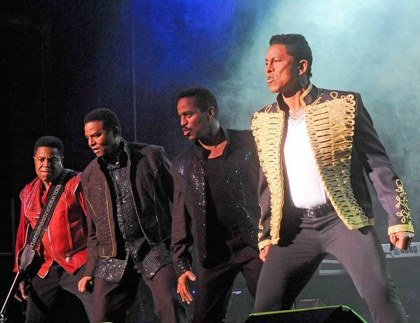 The Jackson 4 -- from left, Tito, Jackie, Marlon and Jermaine -- perform at Bergen Performing Arts Center on June 30, 2012, in Englewood City, N.J.
