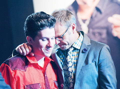 "Hagerstown native Justin Warner, left, and his mentor, Alton Brown, take a moment during the finale of ""The Next Food Network Star"" after Warner was announced as the winner. Warner won the chance to have Food Network air his cooking series, ""Rebel with a Culinary Cause."""