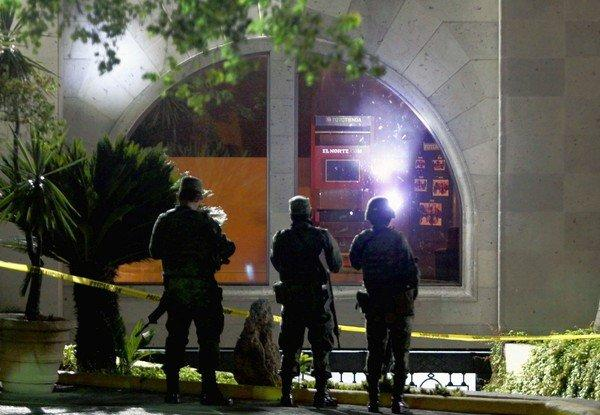 Soldiers guard the entrance to the offices of El Norte newspaper in Monterrey, Mexico, after a grenade explosion this month. El Norte belongs to the Reforma newspaper group that came under attack.