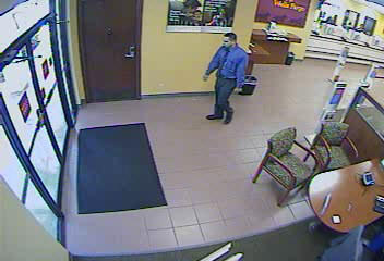 The FBI is looking for a well-dressed suspect who robbed a Wells Fargo bank in Sunrise