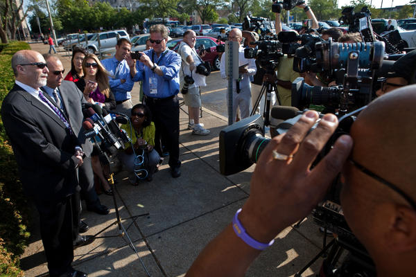 Joel Brodsky and Steve Greenberg, attorneys for Drew Peterson, talk to the media outside the Will County Courthouse in Joliet on the first day of Peterson's trial.