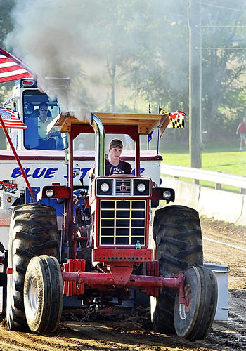 Jamie Baker of Boonsboro competes in the over 100 horsepower class at the Youth Tractor Pull Monday night at the Washington County Ag Expo and Fair.