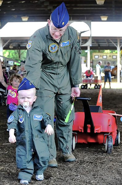 Robbie Nichols, 1, dressed like his dad, U.S. Air Force Maj. Isham Nichols, during the Babies on Parade event Monday night at the Washington County Ag Expo and Fair. Nichols is stationed at Fort Belvoir, Va.