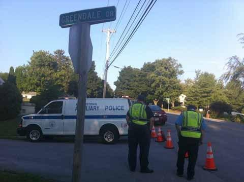 Hagerstown Auxiliary Police officers temporarily close Greendale Drive Monday night while the Washington County Special Response Team and Maryland State Fire Marshal's Office investigate the home of a man who called a suicide hot line.