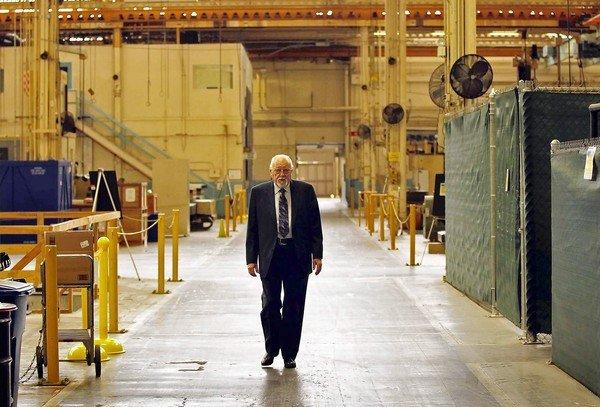 Longtime Rocketdyne engineer Robert Biggs walks through the company's Canoga Park facility last year, where machines that once made parts for spacecraft sit dormant. Much of the workforce has been moved to a larger facility nearby.