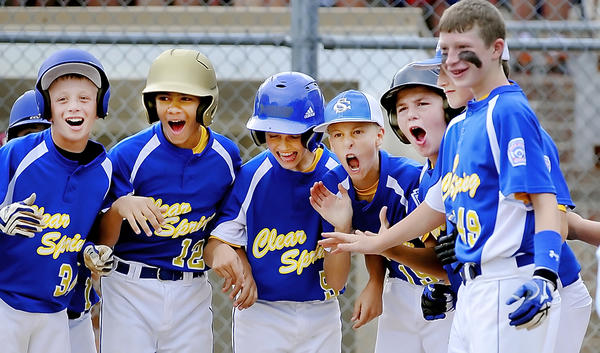 Clear Spring players celebrate Jaret Lazich's grand slam against Brunswick during Monday's winners' bracket semifinal at the Maryland 11-12 Little League state tournament in Brunswick.