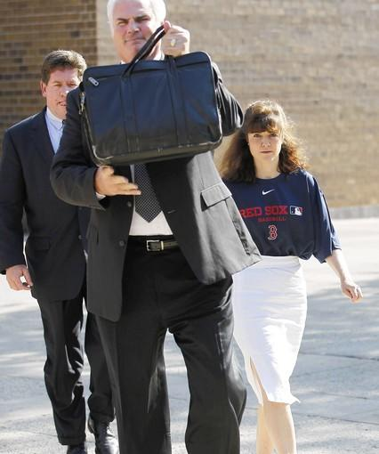 Kathleen Kearney, who is charged with stalking Cubs president Theo Epstein, follows attorney Michael O'Donnell to the Cook County courthouse Monday at Belmont and Western avenues. She was released on bond and allowed to return to Massachusetts for mental health treatment.
