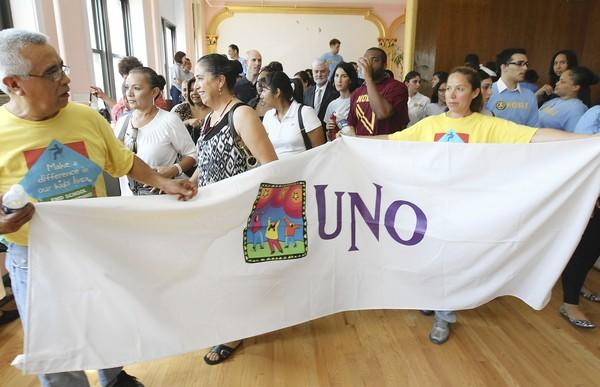 At a rally Monday, supporters of the United Neighborhood Organization and other charter school networks urge the Chicago school board to deliver the $76 million allocated to charter campuses in the proposed budget.