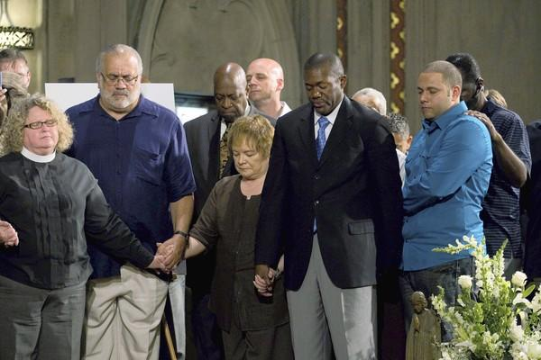 Pastors from throughout the Chicago area pray during a press conference about gun violence.