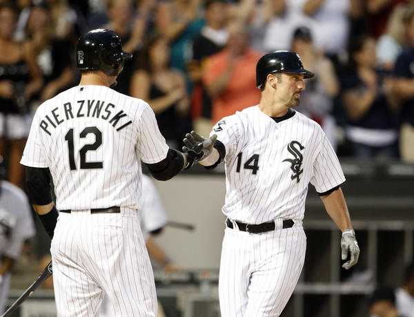 A.J. Pierzynski congratulates Paul Konerko (14), who came around to score on Alex Rios' home run.