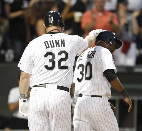 Adam Dunn gives Alejandro De Aza a celebratory pat after hitting a two-run homer.