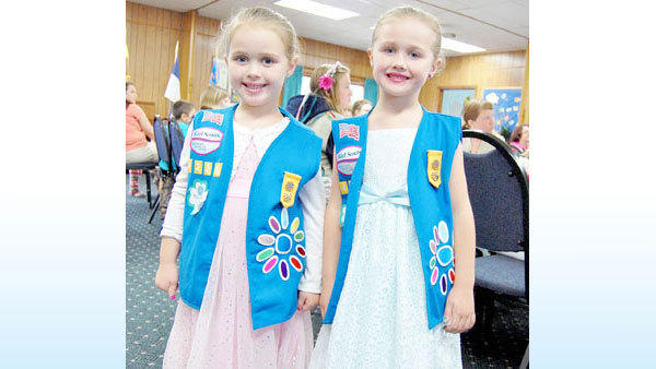 The Goddard twins, Emma and Grace, age 6, are Daisy Girl Scout (ages 5 to 7 years old). Their grandmother, Rosie Warner-Enderle, a 30-year participant in the Scouts, co-leads the Daisy troop with the twin's Aunt Karen. Their mother, Kristen, was a 10-year participant.